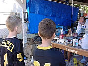 Daerek and Josh watching the geode being cut